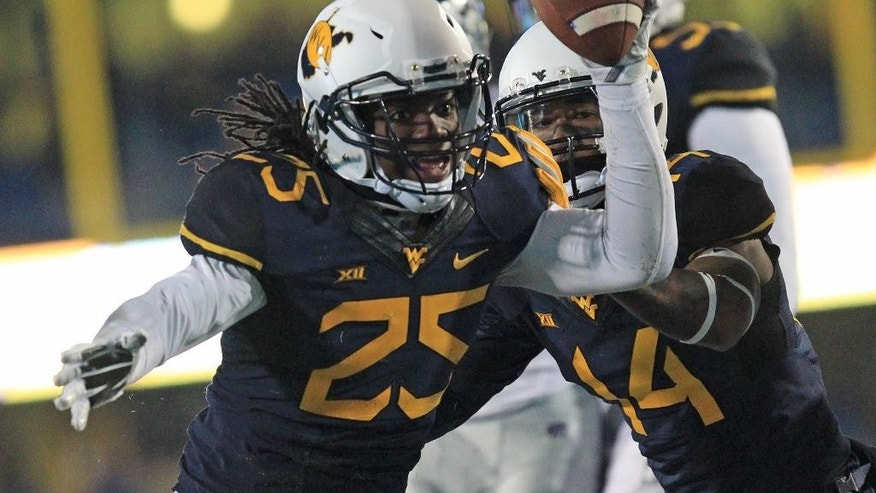 West Virginia's Dayron Wilson (25) reacts to recovering a fumble during the first half of an NCAA college football game against Kansas State in Morgantown, W.Va., on Thursday, Nov. 20, 2014. (AP Photo/Chris Jackson)