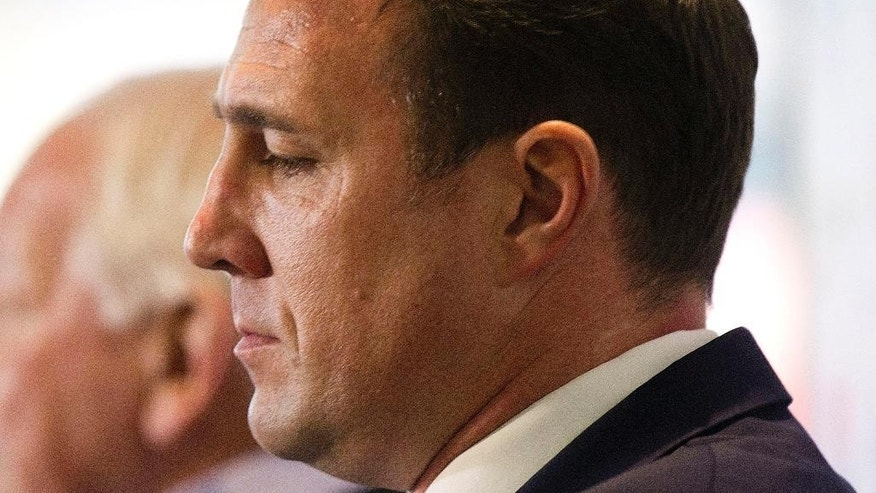 """Wigan Athletic's new manager Malky Mackay and Chairman Dave Whelan background pause, during a press conference at the DW Stadium, in Wigan, England,  Wednesday Nov. 19, 2014. Wigan was condemned by English football's anti-discrimination organization for hiring Malky Mackay as its manager on Wednesday while he is still under investigation for offensive comments. Since August, the English Football Association has been looking into a dossier from Mackay's time as Cardiff manager, including text messages he acknowledged were """"completely unacceptable, inappropriate."""" (AP Photo/PA, Barrington Coombs) UNITED KINGDOM OUT"""