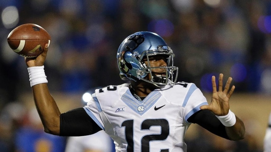 North Carolina quarterback Marquise Williams (12) passes during the first half of an NCAA college football game against Duke in Durham, N.C., Thursday, Nov. 20, 2014. (AP Photo/Gerry Broome)