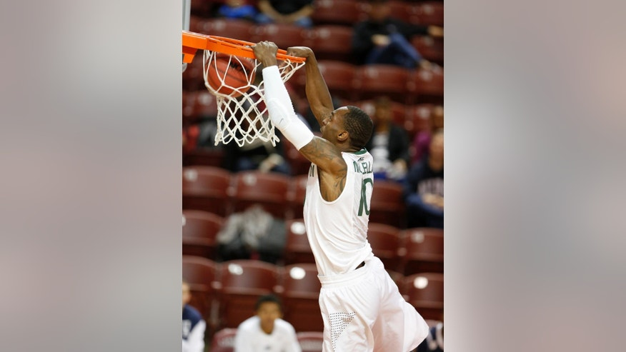 Miami's Sheldon McClellan performs a 360 dunk against Akron during the first half of an NCAA college basketball game at the Charleston Classic tournament in Charleston, S.C., Friday, Nov. 21, 2014. (AP Photo/Mic Smith)