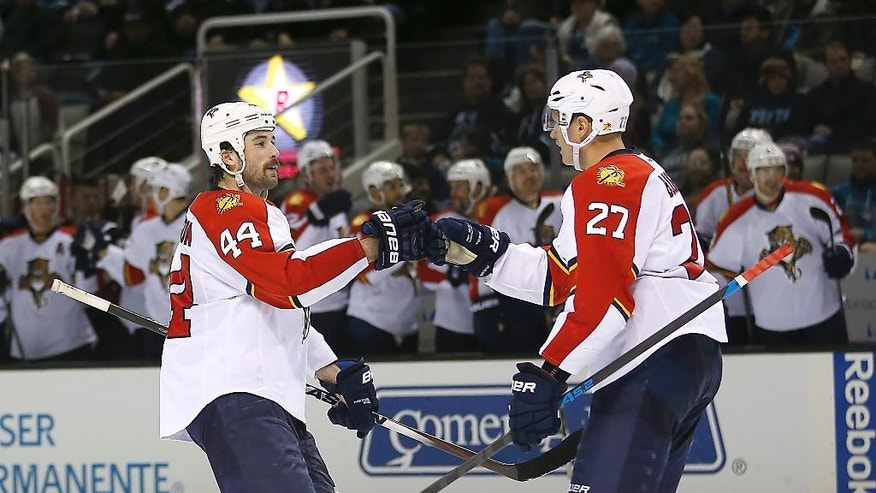 Florida Panthers center Nick Bjugstad (27) celebrates with Erik Gudbranson (44) after scoring a goal against the San Jose Sharks during the second period of an NHL hockey game Thursday, Nov. 20, 2014, in San Jose, Calif. (AP Photo/Tony Avelar)