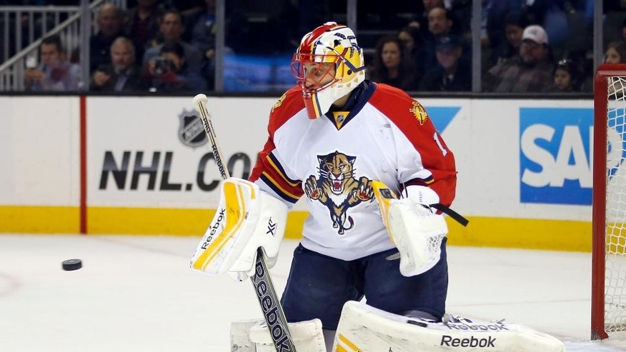 Florida Panthers goalie Roberto Luongo turns the puck away during the first period of an NHL hockey game against the San Jose Sharks on Thursday, Nov. 20, 2014, in San Jose, Calif. (AP Photo/Tony Avelar)