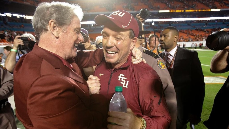 Florida State president John Thrasher, left, congratulates head coach Jimbo Fisher after Florida State defeated Miami 30-26 in an NCAA College football game, Saturday, Nov. 15, 2014 in Miami Gardens, Fla. (AP Photo/Wilfredo Lee)