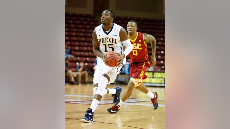 Drexel's Mohamed Bah, left, drives to the basket past Southern California's Darion Clark during the first half of an NCAA college basketball game at the Charleston Classic tournament in Charleston, S.C., Friday, Nov. 21, 2014. (AP Photo/Mic Smith)