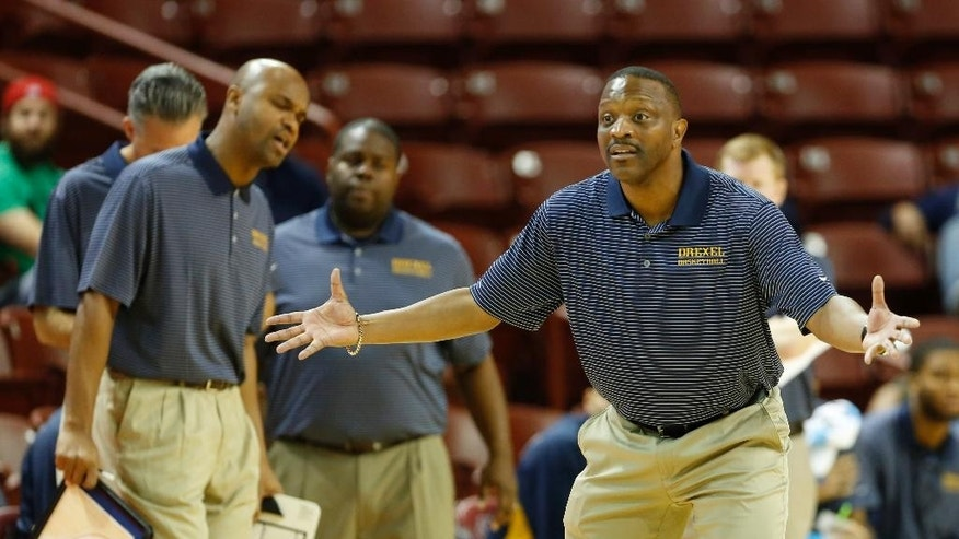 Drexel's head coach James Flint, right, gestures to his players during the second half of an NCAA college basketball game Southern California at the Charleston Classic tournament in Charleston, S.C., Friday, Nov. 21, 2014. (AP Photo/Mic Smith)