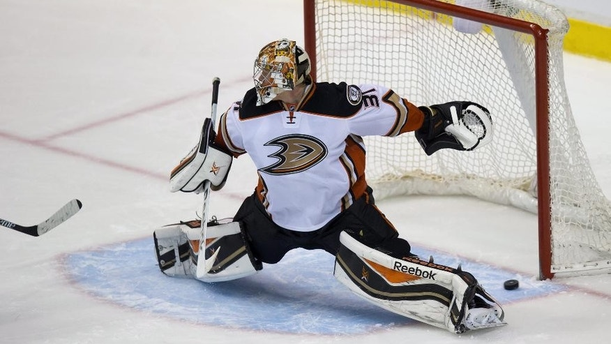 A shot by Vancouver Canucks' Daniel Sedin goes below the legs of Anaheim Ducks goalie Frederik Andersen, of Denmark, but stays out of the net during overtime period in an NHL hockey game Thursday, Nov. 20, 2014, in Vancouver, British Columbia. The Ducks won 4-3. (AP Photo/The Canadian Press, Darryl Dyck)