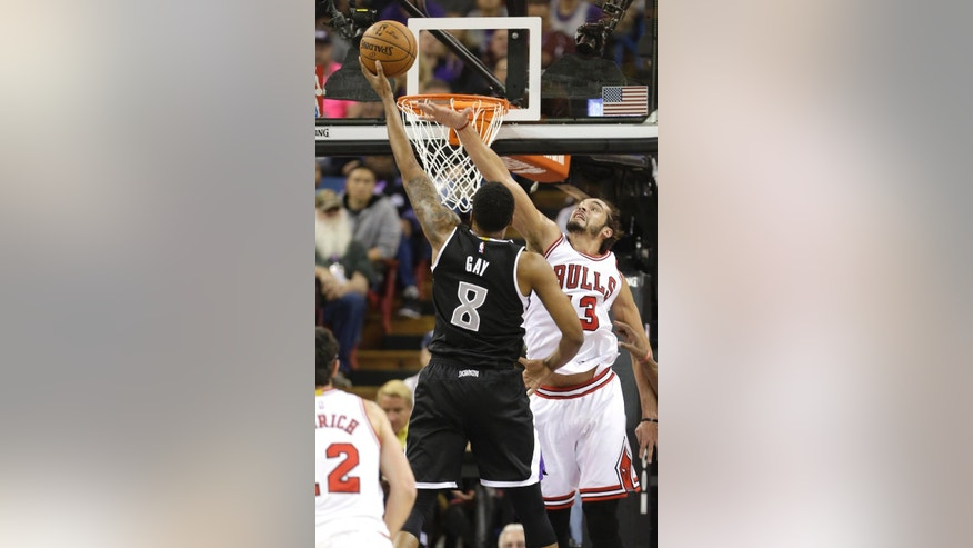 Sacramento Kings forward Rudy Gay, let, drives to the basket against Chicago Bulls center Joakim Noah during the first quarter of an NBA basketball game in Sacramento, Calif., Thursday, Nov. 20, 2014. (AP Photo/Rich Pedroncelli)