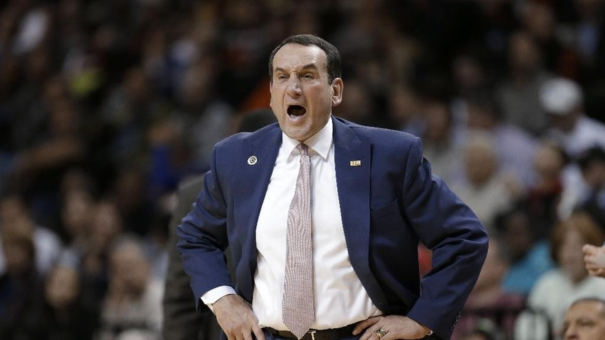 Duke coach Mike Krzyzewski yells during the first half of an NCAA college basketball game against Temple on Friday, Nov. 21, 2014, in New York. (AP Photo/Seth Wenig)