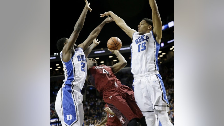 Temple's Daniel Dingle, center, shoots between Duke's Jahlil Okafor, right, and Amile Jefferson during the first half of an NCAA college basketball game in New York, Friday, Nov. 21, 2014. (AP Photo/Seth Wenig)