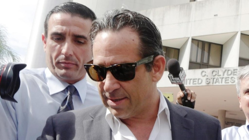 FILE - In this Aug. 5, 2014, file photo, Anthony Bosch, foreground, former owner of the Biogenesis of America clinic, leaves the federal courthouse in Miami after paying bond. The attorney for former University of Miami pitching coach Lazaro Collazo is seeking a wide range of Major League Baseball records for the coach's upcoming trial on illegal performance-enhancing drug distribution charges. That includes details of an immunity deal given to New York Yankees star Alex Rodriguez, who served a season-long suspension this year for violating MLB's drug agreement and, according to court documents, has admitted to the U.S. Drug Enforcement Administration that he used steroids provided by Biogenesis and its former owner, Anthony Bosch. (AP Photo/Alan Diaz, File)