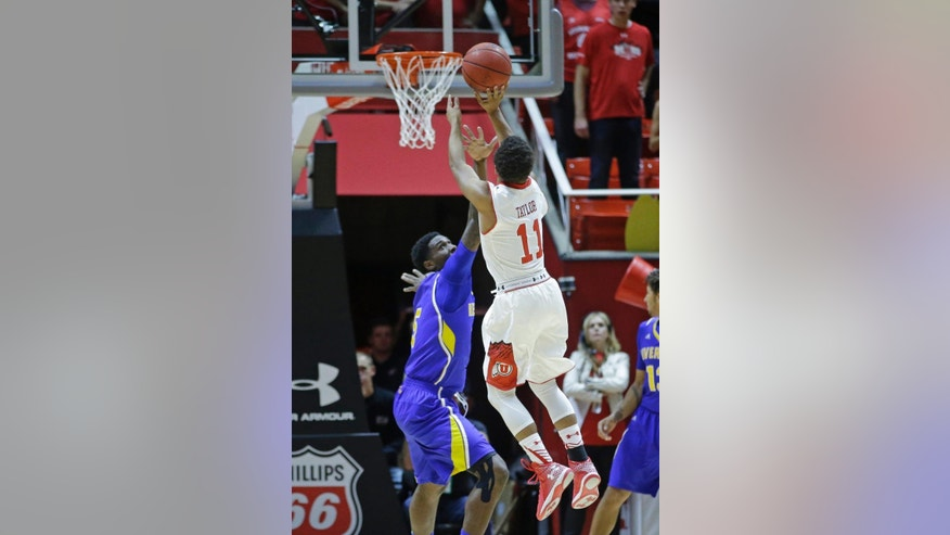Utah's Brandon Taylor (11) shoots as UC Riverside's Taylor Johns (5) defends in the first half during an NCAA college basketball game Friday, Nov. 21, 2014, in Salt Lake City. (AP Photo/Rick Bowmer)