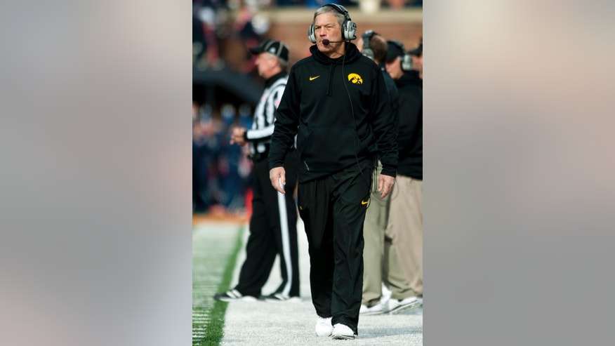 Iowa head coach Kirk Ferentz walks the sidelines during the second quarter of an NCAA football game against Illinois Saturday, Nov. 15, 2014, at Memorial Stadium in Champaign, Ill. (AP Photo/Bradley Leeb)