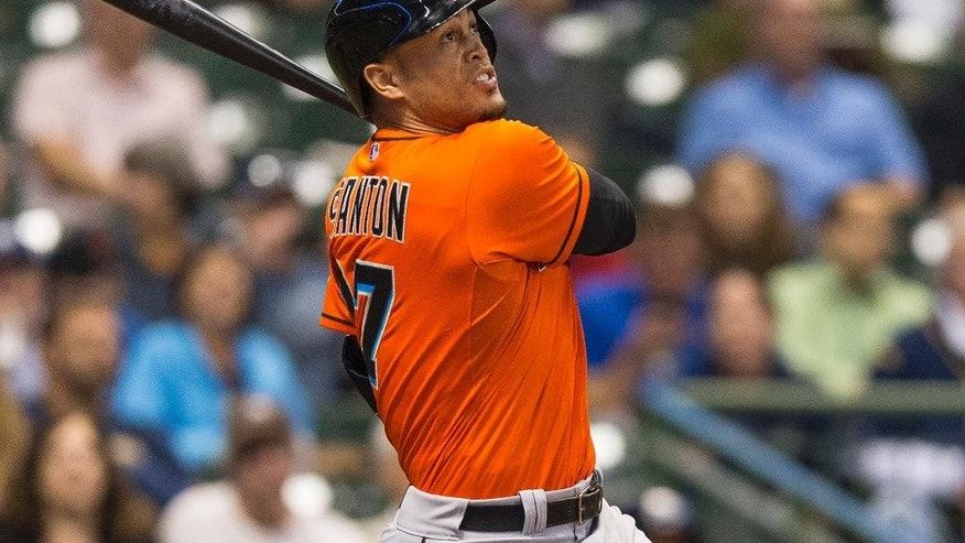 FILE - In this Sept. 8, 2014, file photo, Miami Marlins' Giancarlo Stanton follows through on a solo home run of off Milwaukee Brewers' Yovani Gallardo during the third inning of a baseball game in Milwaukee. Former Philadelphia Phillies third baseman Mike Schmidt says the Marlins might have made Stanton too rich too early. (AP Photo/Tom Lynn, File)