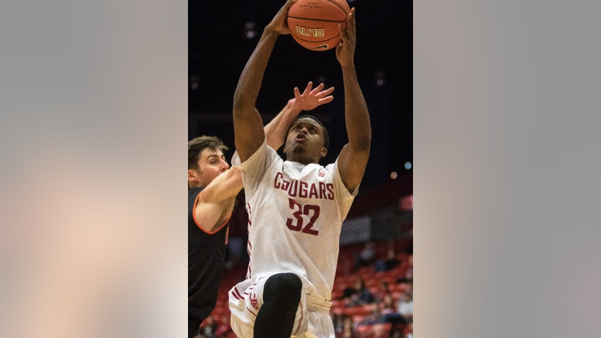 Washington State guard Que Johnson (32) draws a foul on Idaho State guard Ben Wilson as he drives to the basket during the first half of an NCAA college basketball game on Friday, Nov. 21, 2014, in Pullman, Wash. (AP Photo/Dean Hare)