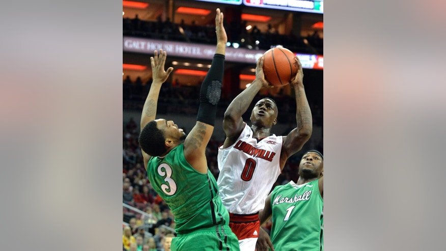 Louisville's Terry Rozier, right, shoots over the defense of Marshall's Jay Johnson during the second half of an NCAA college basketball game Friday, Nov. 21, 2014, in Louisville, Ky. Louisville won 85-67. (AP Photo/Timothy D. Easley)
