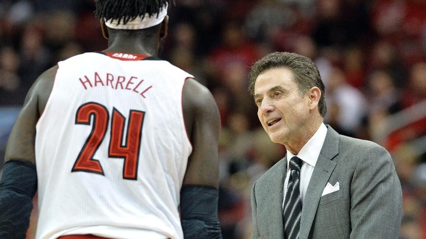 Louisville head coach Rick Pitino, right, talks with Montrezl Harrell during the first half of an NCAA college basketball game against Marshall, Friday, Nov. 21, 2014, in Louisville, Ky. (AP Photo/Timothy D. Easley)