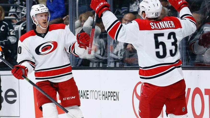 Carolina Hurricanes left wing Jeff Skinner, right, celebrates his goal with center Riley Nash, left, against the Los Angeles Kings during the first period of an NHL hockey game, Thursday, Nov. 20, 2014, in Los Angeles. (AP Photo/Danny Moloshok)
