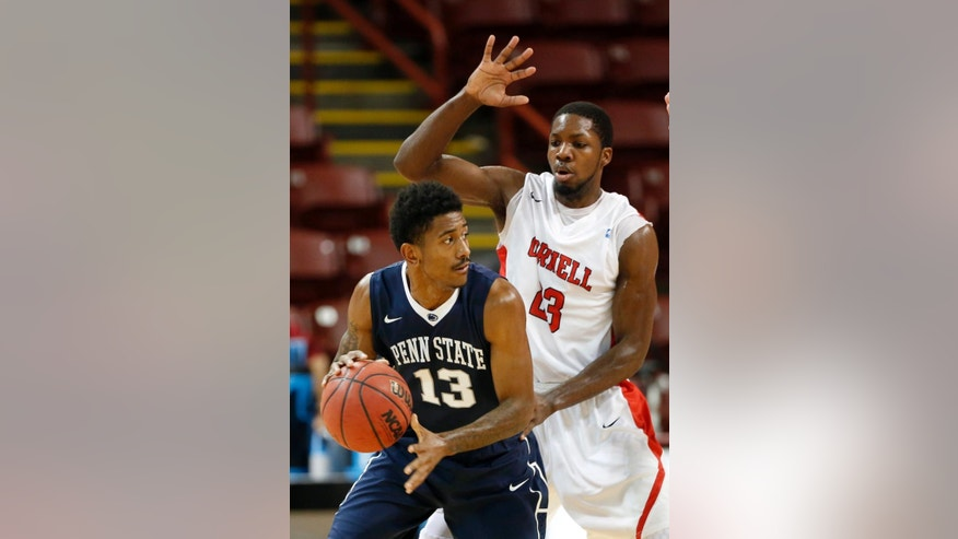 Penn State's Geno Thorpe, left, controls the ball against Cornell's Galal Cancer during the first half at the Charleston Classic NCAA college basketball tournament in Charleston, S.C., Friday, Nov. 21, 2014. (AP Photo/Mic Smith)
