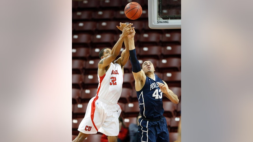 Cornell's Shonn Miller, left, fights for a rebound with Penn State's Ross Travis during the first half at the Charleston Classic NCAA college basketball tournament in Charleston, S.C., Friday, Nov. 21, 2014. (AP Photo/Mic Smith)