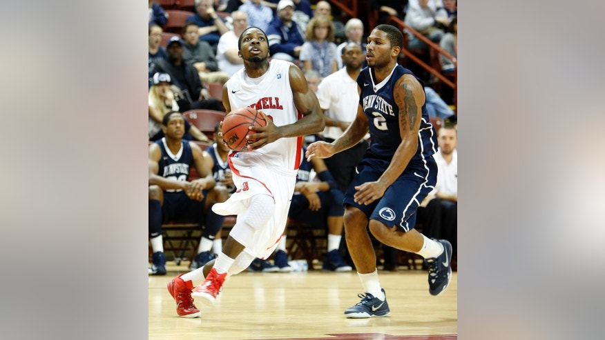 Cornell's Galal Cancer, left, drives against Penn State's D.J. Newbill, right, during the first half at the Charleston Classic NCAA college basketball tournament in Charleston, S.C., Friday, Nov. 21, 2014. (AP Photo/Mic Smith)