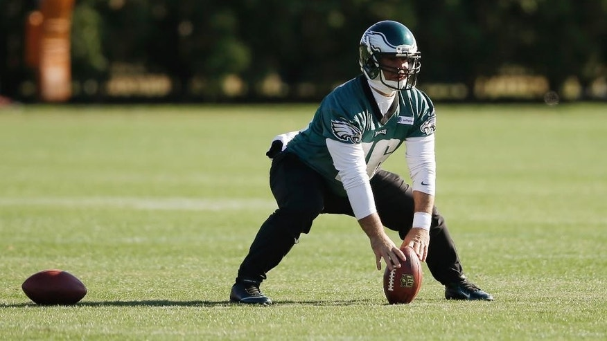 In this photo taken on Tuesday, Nov. 18, 2014, Philadelphia Eagles long-snapper Jon Dorenbos prepares to snap the ball during NFL football practice at the team's training facility in Philadelphia. Dorenbos turned to magic as a kid when his father murdered his mother. It helped him through a traumatic time and he's turned it into a nice side career. And, he's pretty good at his day job, too: Dorenbos has been a long snapper for the Philadelphia Eagles for nearly a decade. (AP Photo/Matt Rourke)