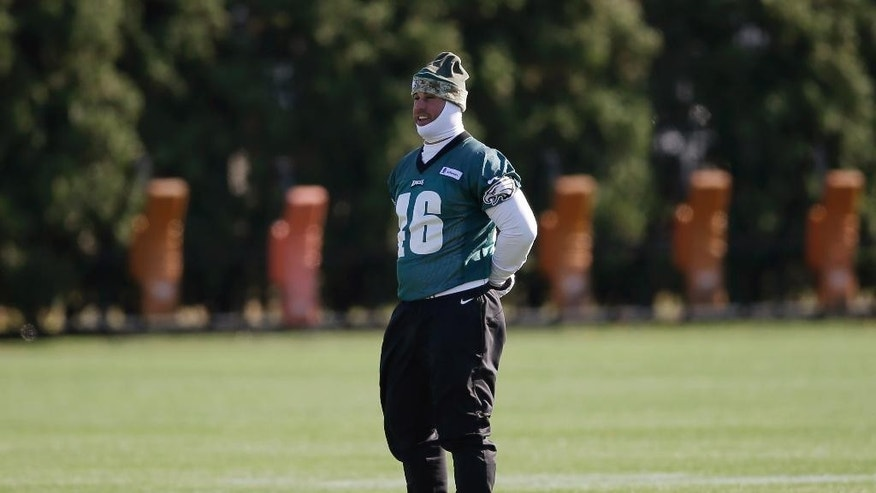 In this photo taken on Tuesday, Nov. 18, 2014, Philadelphia Eagles long-snapper Jon Dorenbos waits to run a drill during NFL football practice at the team's training facility in Philadelphia. Dorenbos turned to magic as a kid when his father murdered his mother. It helped him through a traumatic time and he's turned it into a nice side career. And, he's pretty good at his day job, too: Dorenbos has been a long snapper for the Philadelphia Eagles for nearly a decade. (AP Photo/Matt Rourke)