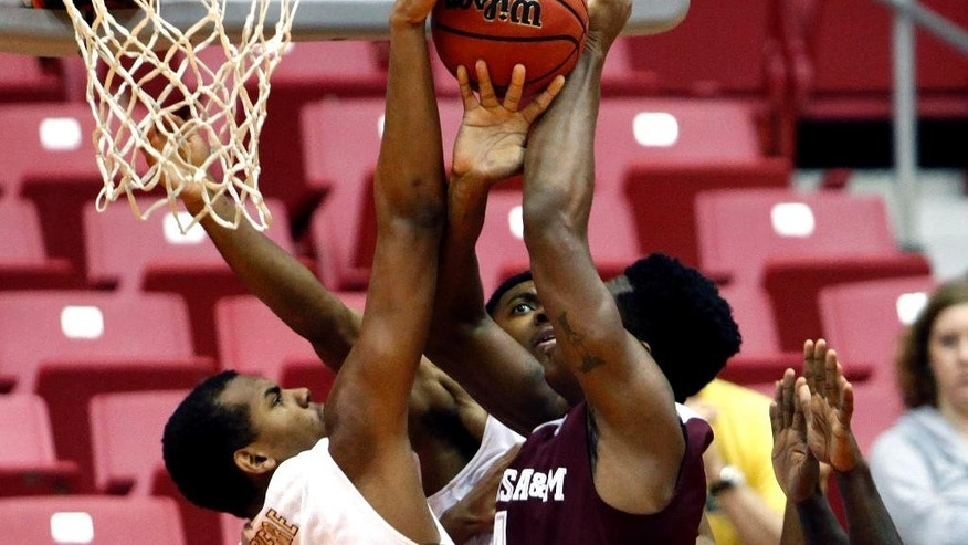 College of Charleston forward Glen Pierre, left, and teammate forward Donovan Gilmore battle for a rebound against Texas A&M forward Tavario Miller, right center, during a NCAA college basketball game in San Juan, Puerto Rico, Friday, Nov. 21, 2014. (AP Photo/Ricardo Arduengo)
