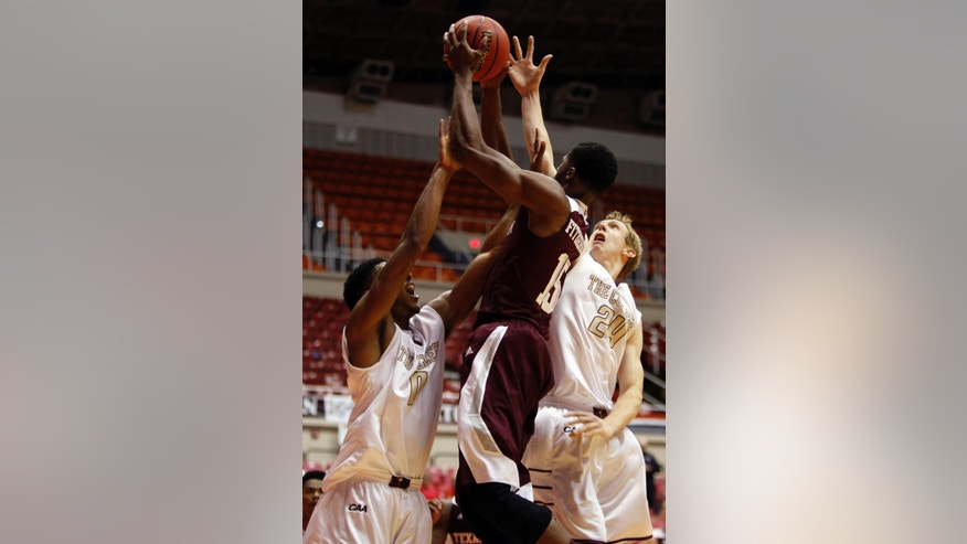 College of Charleston forward Donovan Gilmore, left, and teammate Canyon Barry, battle for a rebound against Texas A&M forward Davonte Fitzgerald during a NCAA college basketball game in San Juan, Puerto Rico, Friday, Nov. 21, 2014. (AP Photo/Ricardo Arduengo)
