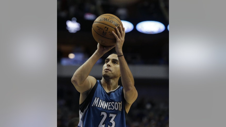 Minnesota Timberwolves guard Kevin Martin (23) shoots a free throw during the second half of an NBA basketball game against the Dallas Mavericks, Saturday, Nov. 15, 2014, in Dallas. (AP Photo/LM Otero)