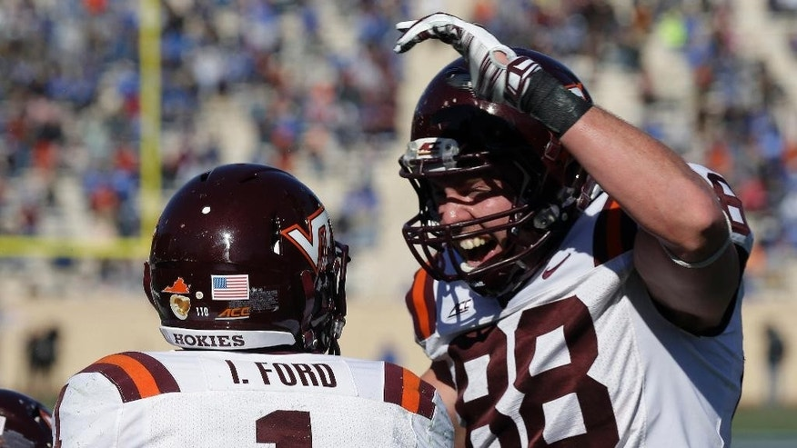 Virginia Tech's Isaiah Ford (1) and Ryan Malleck (88) celebrate Ford's touchdown against Duke during the first half of an NCAA college football game in Durham, N.C., Saturday, Nov. 15, 2014. Virginia Tech won 17-16. (AP Photo/Gerry Broome)