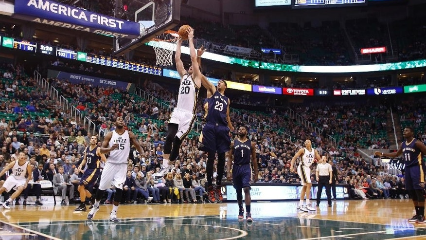 Utah Jazz forward Gordon Hayward (20) takes a shot while defended by New Orleans Pelicans forward Anthony Davis (23) during the second half of their NBA Basketball game in Salt Lake City, Utah, Saturday, Nov. 22, 2014. The New Orleans Pelicans won 106 - 94. (AP Photo/Jim Urquhart)