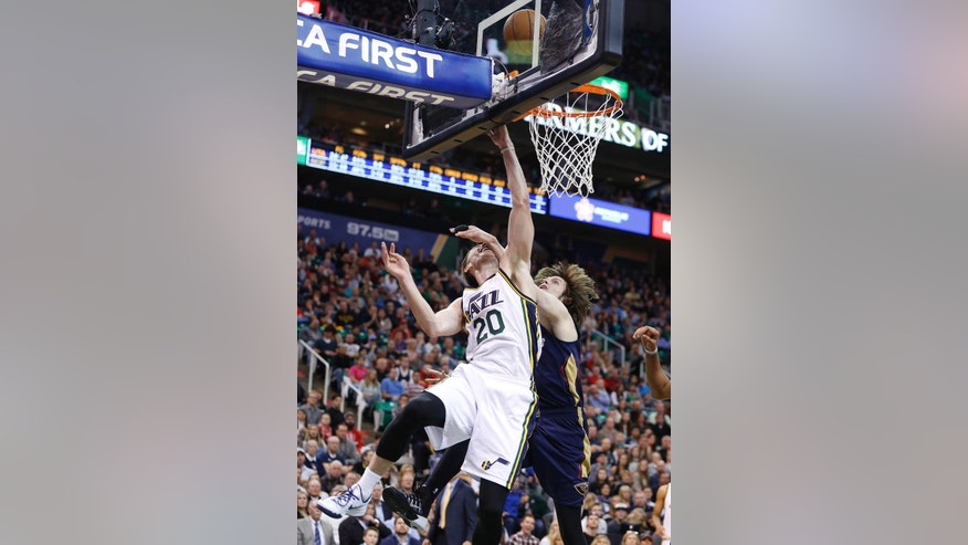 Utah Jazz forward Gordon Hayward (20) is fouled on a shot by New Orleans Pelicans forward Luke Babbitt (8) during the second half of their NBA Basketball game in Salt Lake City, Utah, Saturday, Nov. 22, 2014. The New Orleans Pelicans won 106 - 94. (AP Photo/Jim Urquhart)
