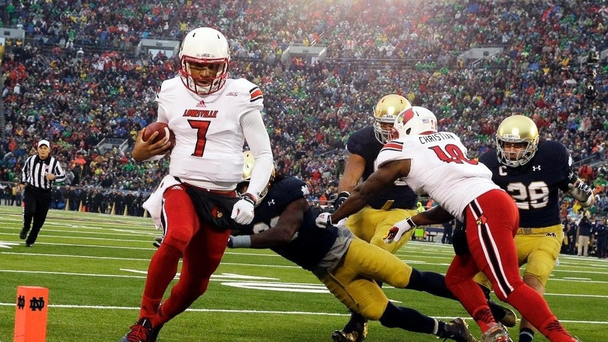 Louisville quarterback Reggie Bonnafon (7) scores a touchdown during the first half of an NCAA college football game against Notre Dame in South Bend, Ind., Saturday, Nov. 22, 2014. (AP Photo/Nam Y. Huh)