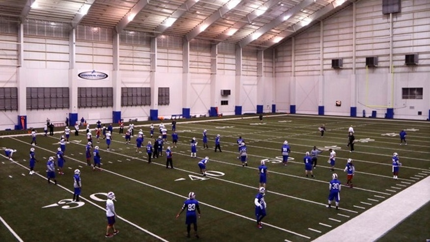 The Buffalo Bills open an NFL football practice at the Detroit Lions training facility in Allen Park, Mich., Friday, Nov. 21, 2014. They'll use the facility in preparation for Monday's game against the Jets, which was moved to Detroit because of the snowstorm in Buffalo. (AP Photo/Carlos Osorio)