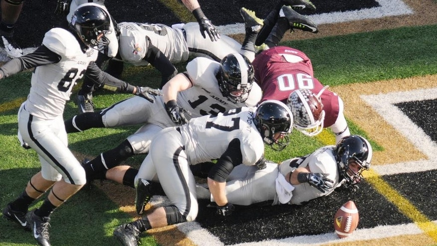 Army defensive back Lamar Johnson-Harris (16) recovers a blocked punt for a touchdown against Fordham during the first half of an NCAA college football on Saturday, Nov. 22, 2014, in West Point, N.Y. (AP Photo/Hans Pennink)
