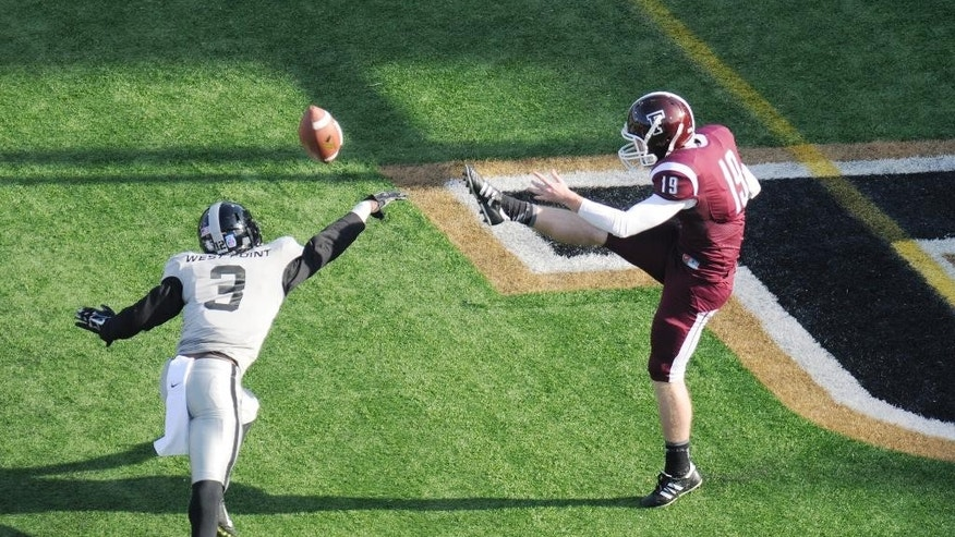 Army defensive back Josh Jenkins (3) blocks a kick by Fordham punter Joseph Pavlik's (19) during the first half of an NCAA college football on Saturday, Nov. 22, 2014, in West Point, N.Y. (AP Photo/Hans Pennink)