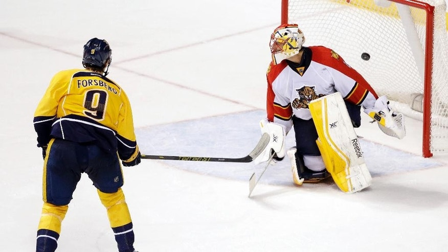Nashville Predators center Filip Forsberg (9), of Sweden, scores against Florida Panthers goalie Roberto Luongo during a shootout in an NHL hockey game Saturday, Nov. 22, 2014, in Nashville, Tenn. The goal gave the Predators a 3-2 win. (AP Photo/Mark Humphrey)