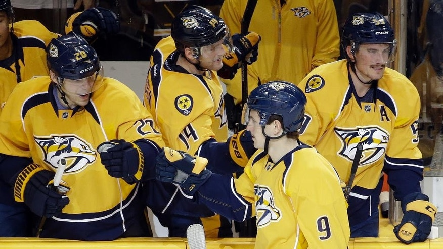 Nashville Predators center Filip Forsberg (9), of Sweden, is congratulated after scoring during a shootout against the Florida Panthers in an NHL hockey game Saturday, Nov. 22, 2014, in Nashville, Tenn. The goal gave the Predators a 3-2 win. (AP Photo/Mark Humphrey)