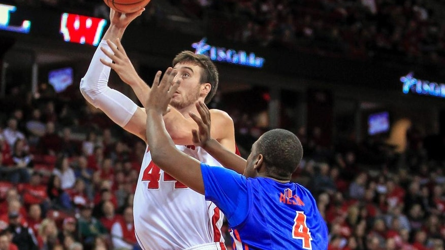 Wisconsin's Frank Kaminsky shoots past Boise State's Kevin Allen (4) during the second half of an NCAA college basketball game Saturday, Nov. 22, 2014, in Madison, Wis. Wisconsin won 78-54. (AP Photo/Andy Manis)