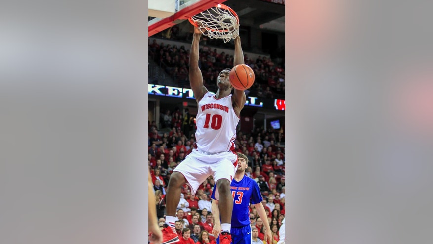 Wisconsin's Nigel Hayes (10) dunks in front of Boise State's Nick Duncan during the second half of an NCAA college basketball game Saturday, Nov. 22, 2014, in Madison, Wis. Wisconsin won 78-54. (AP Photo/Andy Manis)