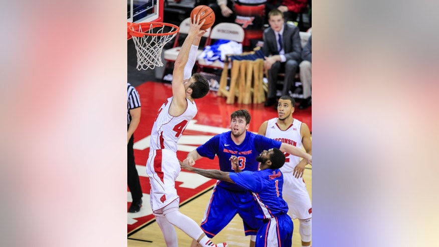 Wisconsin's Frank Kaminsky, left, shoots past Boise State's Nick Duncan (13) and Mikey Thompson (1) during the first half of an NCAA college basketball game Saturday, Nov. 22, 2014, in Madison, Wis. (AP Photo/Andy Manis)