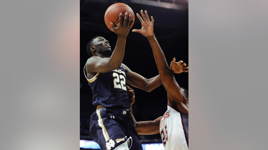 Notre Dame's Jerian Grant, left, goes up for a basket as Massachusetts' Cady Lalanne, right, defends during the first half of an NCAA college basketball game, Saturday, Nov. 22, 2014, in Uncasville, Conn. Notre Dame won 81-68. (AP Photo/Jessica Hill)