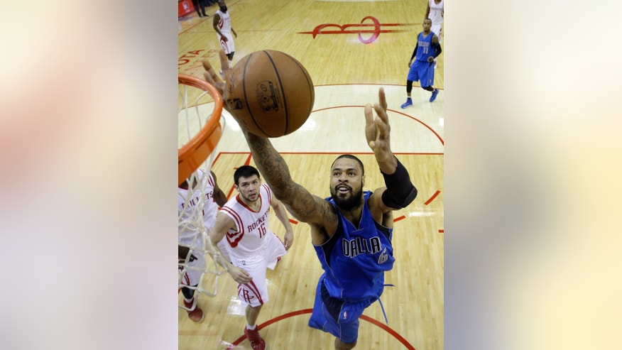 Dallas Mavericks' Tyson Chandler (6) pulls down a rebound in front of Houston Rockets' Kostas Papanikolaou (16) during the first half of an NBA basketball game Saturday, Nov. 22, 2014, in Houston. (AP Photo/David J. Phillip)