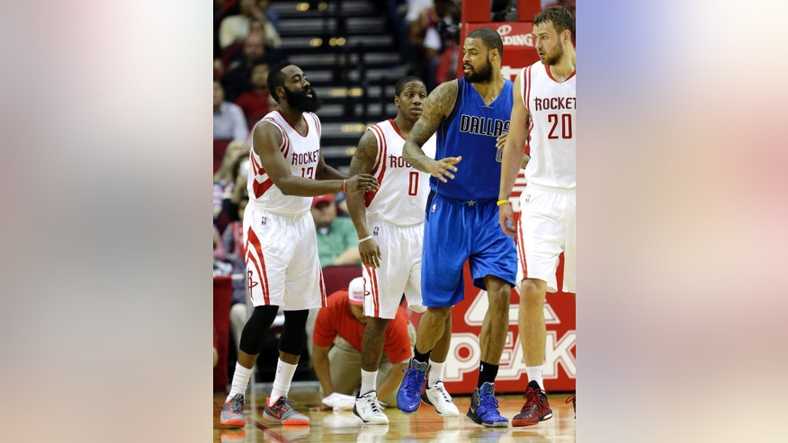 Houston Rockets' James Harden (13) reaches to shove Dallas Mavericks' Tyson Chandler (6) after Harden landed on the floor hard while shooting as Chandler defended during the second quarter of an NBA basketball game Saturday, Nov. 22, 2014, in Houston. Both players were called for a technical foul. (AP Photo/David J. Phillip)