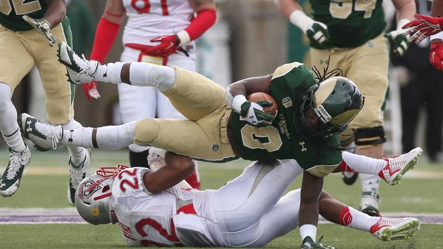 Colorado State running back Dee Hart, top, is upended after a short gain by New Mexico defensive back Markel Byrd in the first quarter of an NCAA college football game in Fort Collins, Colo., on Saturday, Nov. 22, 2014. (AP Photo/David Zalubowski)