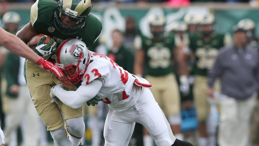 New Mexico defensive back Devonta Tabannah, right, stops Colorado State wide receiver Xavier Williams after he caught a pass for a short gain in the first quarter of an NCAA college football game in Fort Collins, Colo., on Saturday, Nov. 22, 2014. (AP Photo/David Zalubowski)