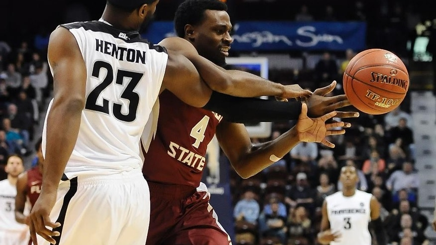 Providence's LaDontae Henton, left, knocks the ball from Florida State's Dayshawn Watkins, right, during the second half of an NCAA college basketball game, Saturday, Nov. 22, 2014, in Uncasville, Conn. Providence won 80-54. (AP Photo/Jessica Hill)