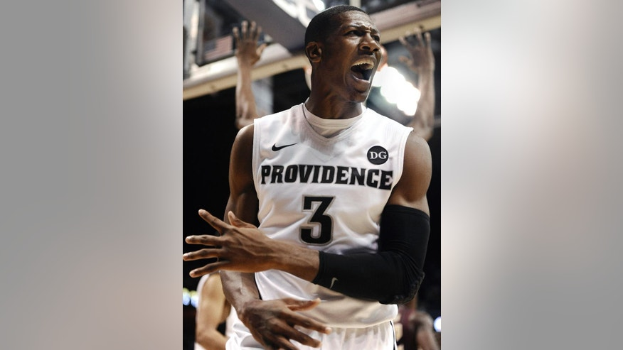 Providence's Kris Dunn reacts during the first half of an NCAA college basketball game against Florida State, Saturday, Nov. 22, 2014, in Uncasville, Conn.  (AP Photo/Jessica Hill)