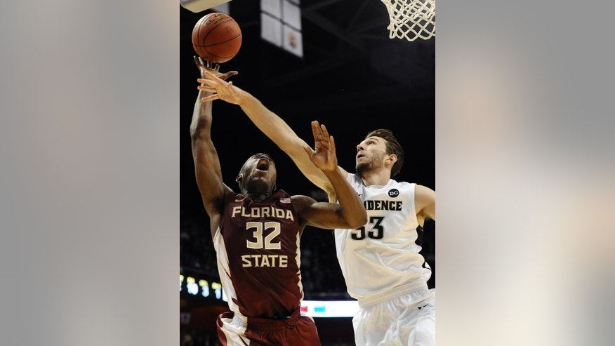 Providence's Carson Desrosiers, right, fouls Florida State's Montay Brandon, left, during the first half of an NCAA college basketball game, Saturday, Nov. 22, 2014, in Uncasville, Conn.  (AP Photo/Jessica Hill)