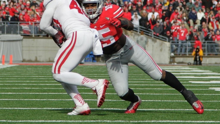 Indiana safety Antonio Allen, left, returns an interception as Ohio State running back Ezekiel Elliott tackles him during the second quarter of an NCAA college football game Saturday, Nov. 22, 2014, in Columbus, Ohio. (AP Photo/Jay LaPrete)